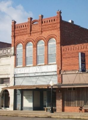 Cowboy Pink Williams Marker and Cowboy Building image. Click for full size.