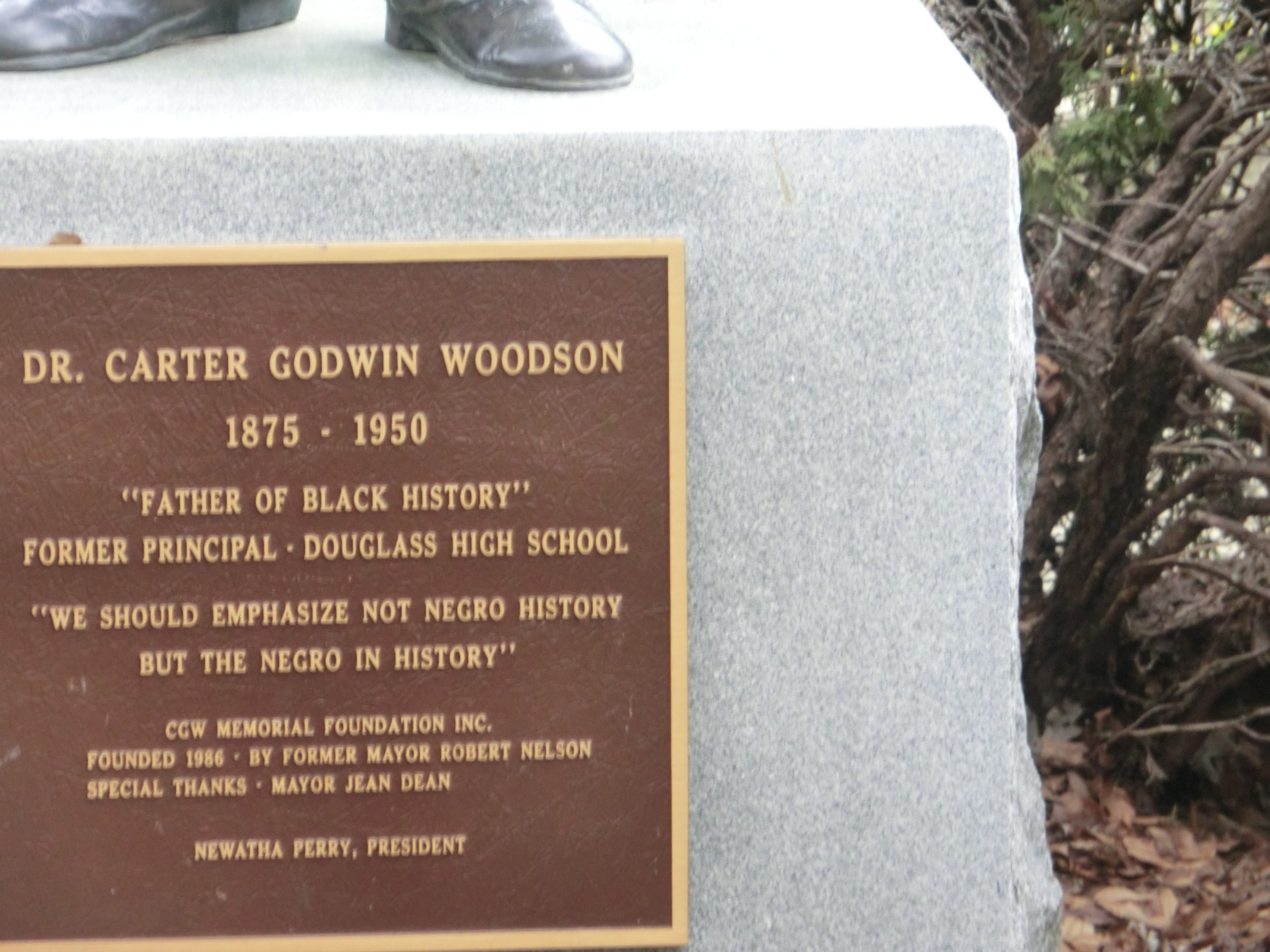 Carter Godwin Woodson plaque at the base of the statue