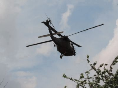 An active DC ANG helicopter preparing to land in the East Capitol Street Park image. Click for full size.