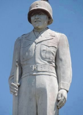 The 442nd Infantry World War II Memorial - statue of a Nisei soldier atop the high pedestal image. Click for full size.