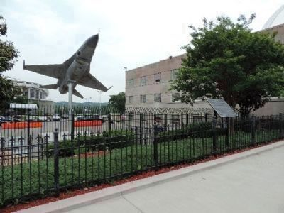 "The ""Fighting Falcon"" on display behind the fence with the marker in view to the right image. Click for full size."