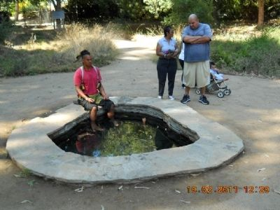 Tongva Sacred Springs Pool with Visitors image. Click for full size.