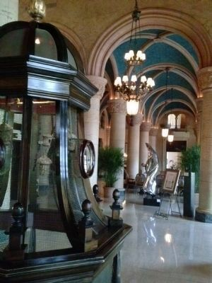 Bird cage, barrel-vaulted ceiling and marble columns in the hotel lobby image. Click for full size.