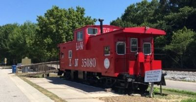 Nearby caboose & railway. image. Click for full size.