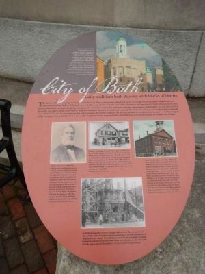 Family traditions built this city with blocks of charity Marker image. Click for full size.