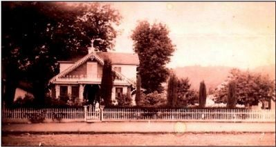 This picture was taken in 1900. Members of the Shaw family can be seen standing on the front porch. image. Click for full size.