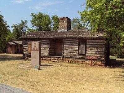 Marker with Douglas Cooper Cabin image. Click for full size.
