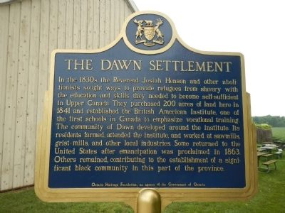 The Dawn Settlement Marker (English side) image. Click for full size.