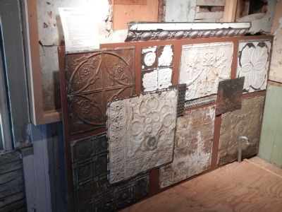 Examples of pressed tin found inside the Sinclair Inn. image. Click for full size.