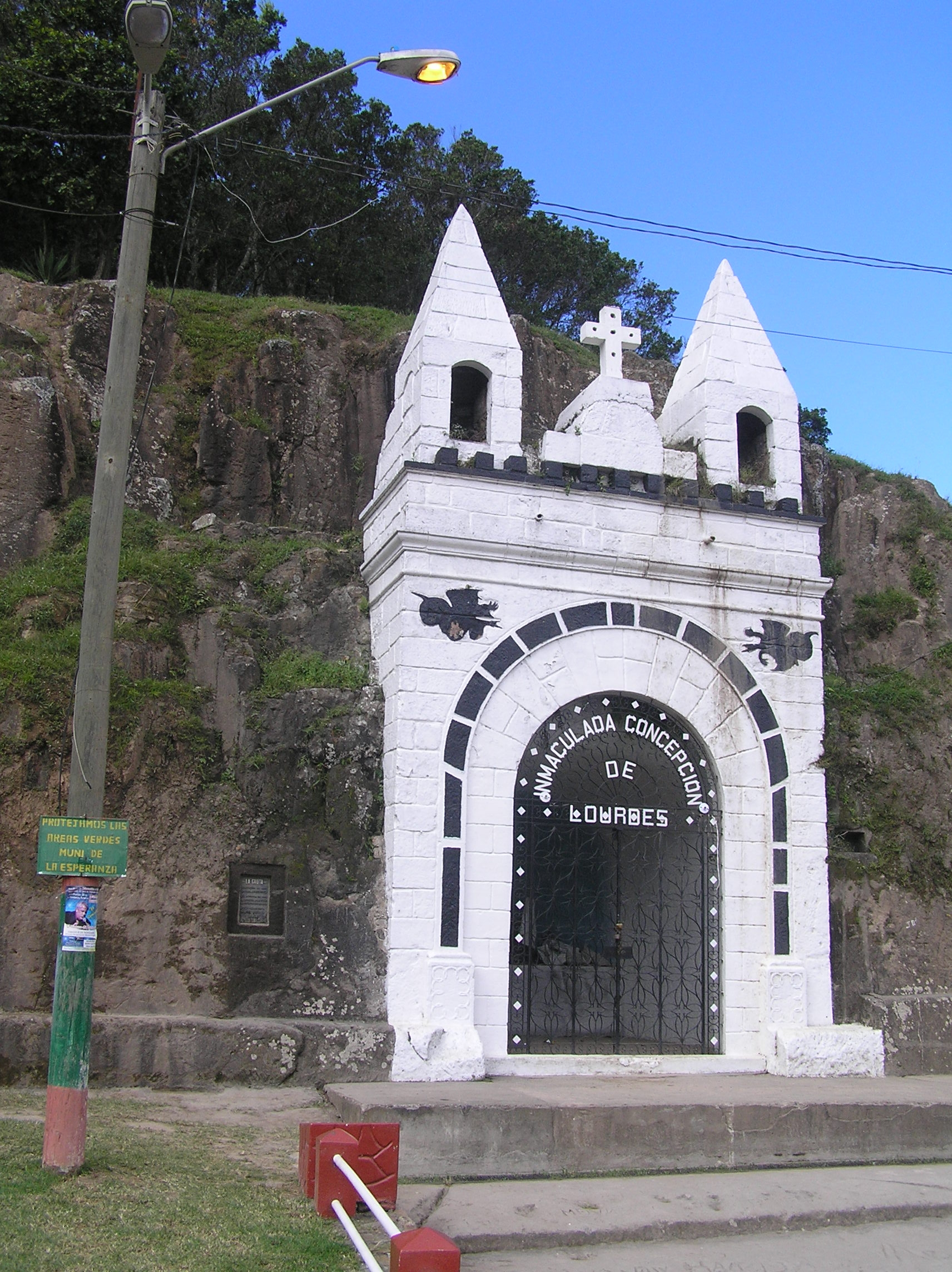 Wide view of Grotto of La Esperanza Marker