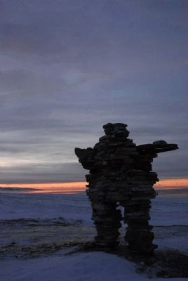 Inukshuk and Sunset near Kuujjuaraapik in January image. Click for full size.