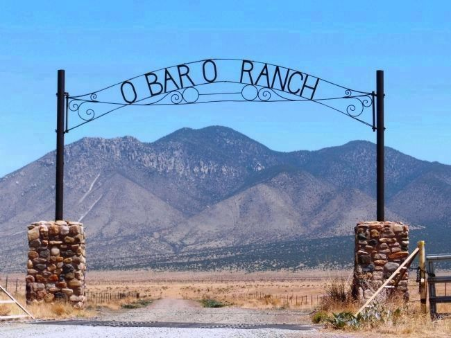 Carrizo Peak, framed by O-Bar-O Ranch Entrance, Capitan, New Mexico image. Click for full size.