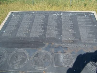 This marker lists the individuals who created and erected the monument. image. Click for full size.