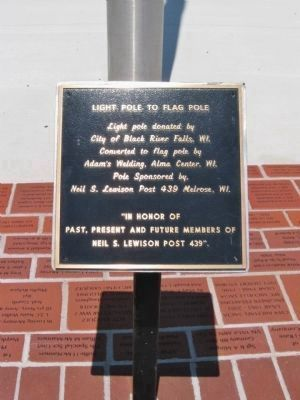 Light Pole to Flag Pole Plaque image. Click for full size.
