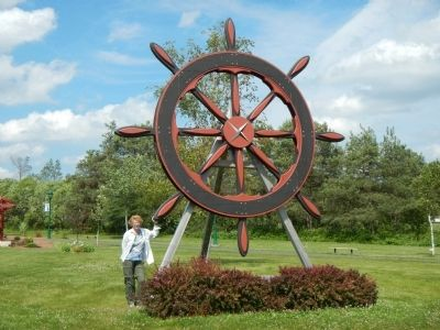 The World's Largest Ship's Wheel located in A.A. MacDonald Memorial Garden image. Click for full size.