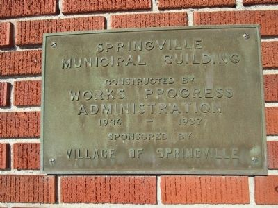 Plaque on the Municipal Building at the Marker Site image. Click for full size.