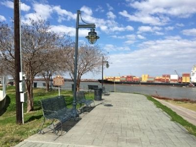 View of marker and container ship on the Mississippi. image. Click for full size.