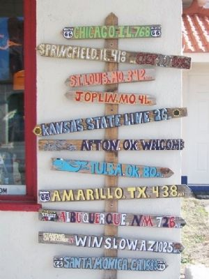 Distance Signs from Eagle (D-X) Service Station image. Click for full size.