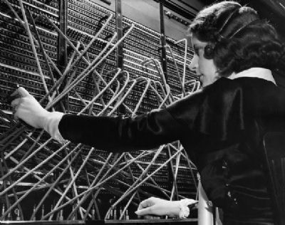 Telephone Operator at Work image. Click for full size.