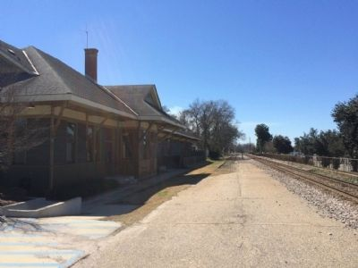 Train Depot along railroad tracks. image. Click for full size.