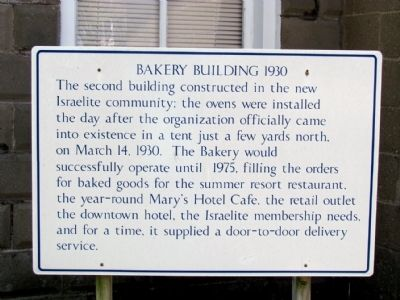 Informational Sign on Bakery Building 1930 image. Click for full size.