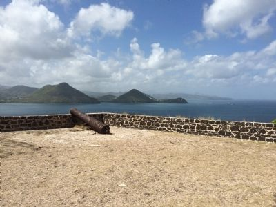 Fort Rodney cannon with a view south to the Pitons. image. Click for full size.