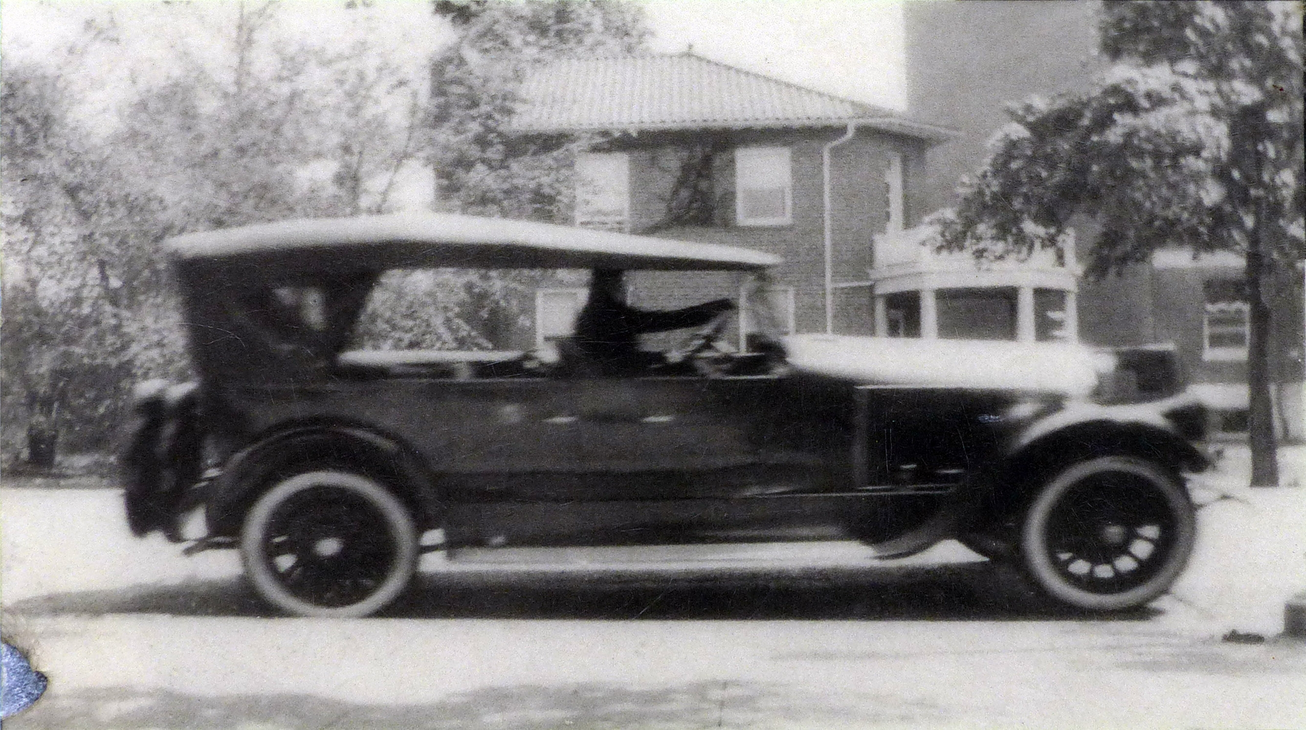 John E. White in car