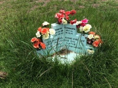 Small monument to two victims of the landslide. image. Click for full size.