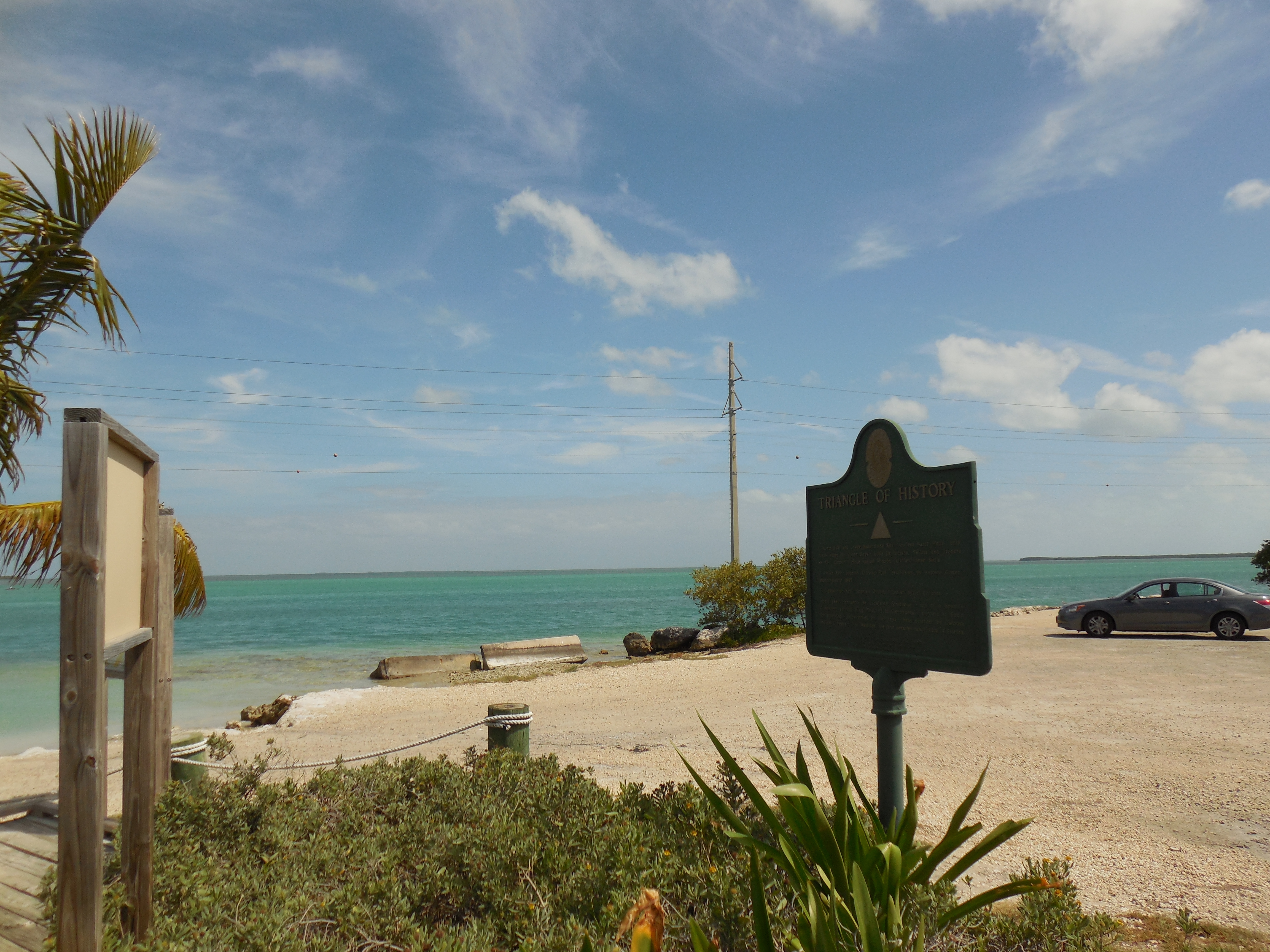 Marker is at a boat launch on the bayside of Overseas Highway.