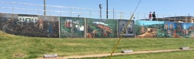 Wide shot of murals behind Simpson County Tourism Office. image. Click for full size.