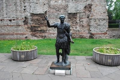 Roman Emperor Trajan Statue with the London Wall in the Background image. Click for full size.