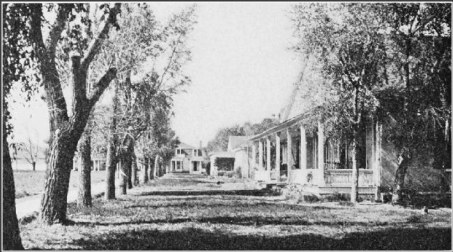 Historic photo of officer's quarters (right forground) described by the marker. image. Click for full size.