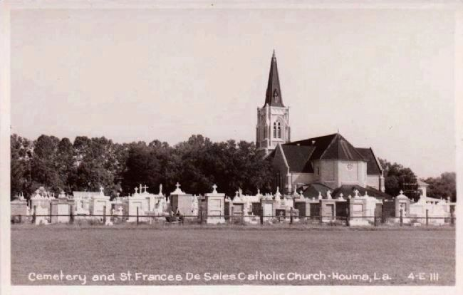 <i>Cemetery and St. Francis De Sales Catholic Church, Houma, La.</i> image. Click for full size.