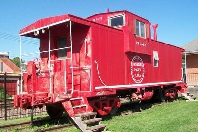 Former Missouri Pacific Railroad Caboose at Depot image. Click for full size.