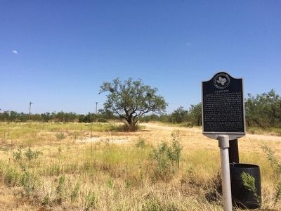 View of marker looking north towards County Road 2121. image. Click for full size.