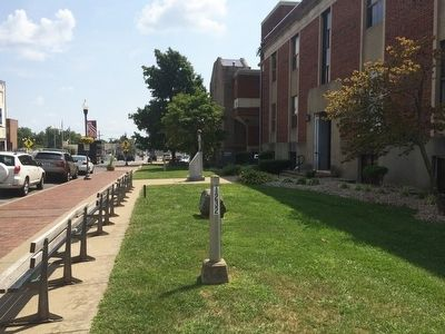 Marker in far background looking east on Center Street. image. Click for full size.