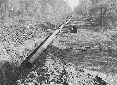 Big Inch pipeline being laid, 1942 image. Click for full size.