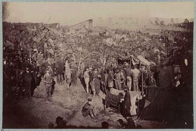 Andersonville Prison, Ga., August 17, 1864. Issuing rations, view from main gate image. Click for full size.