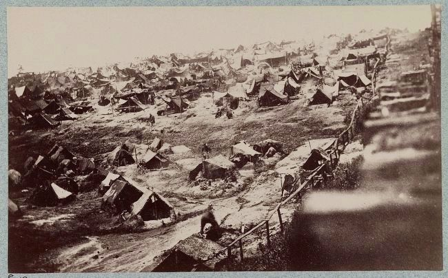 Andersonville Prison, Ga., August 17, 1864. Southwest view of stockade showing the dead-line image. Click for full size.