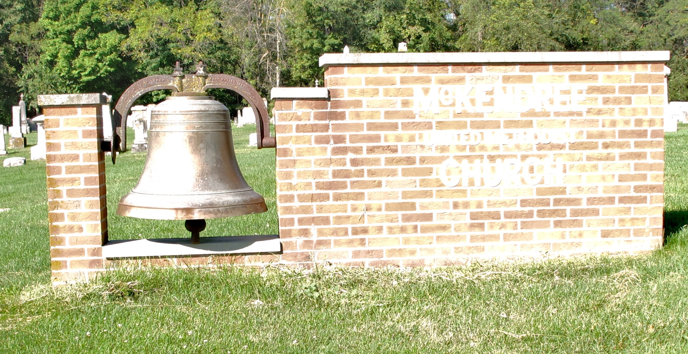 Bell and marquis for the former church that stood at this site
