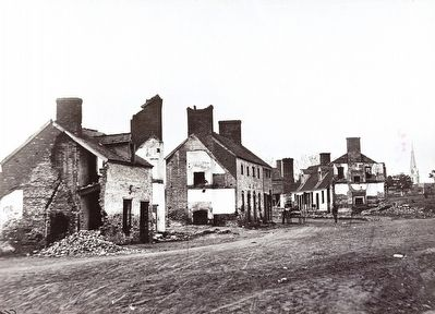 <i>Street in Fredericksburg, Va., showing houses destroyed by bombardment in December, 1862</i> image. Click for full size.