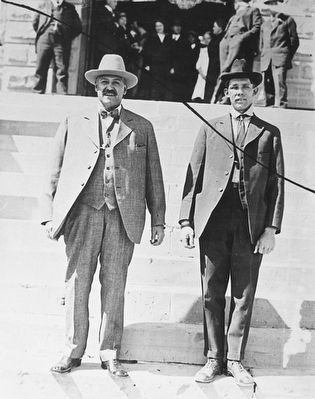 Bill Carlisle, right, and his captor Sheriff Rubie Rivera, on the steps of the Carbon County courtho image. Click for full size.