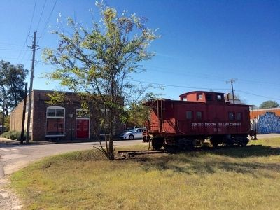 Railway caboose in front of Coleman Center image. Click for full size.