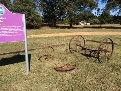 Glendora Gin marker and old wagon wheels. image. Click for full size.