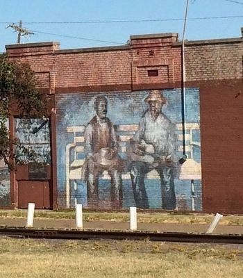 Nearby mural depicting the meeting in 1903 of W.C. Handy & the blues at the railroad depot. image. Click for full size.