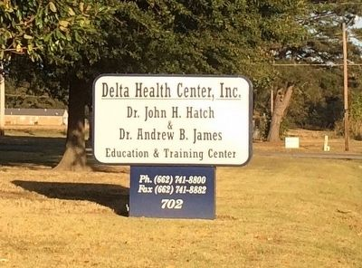 Current Delta Health Center sign. image. Click for full size.