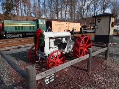 "Tractor next to the Pennsylvania Railroad ""Watch Box"" Marker image. Click for full size."