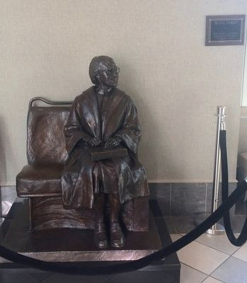 Rosa Parks statue in museum (sitting on bus seat) image. Click for full size.