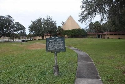 Forest City Marker with church in background image. Click for full size.