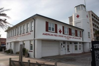 American Red Cross Volunteer Life Saving Corps and Station Marker with building behind image. Click for full size.